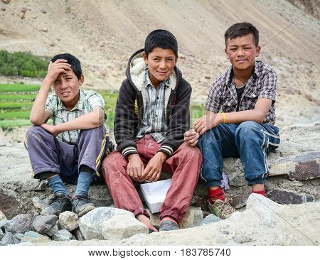 Tibetan Boys Sitting On Road In Nubra Valley, India