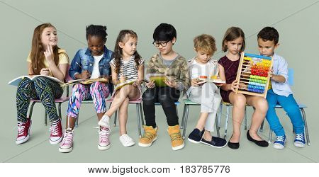 Group of students sit together study