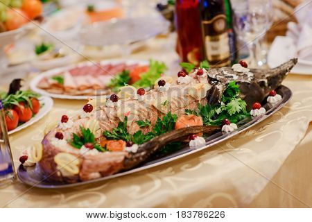 decorated sturgeon served on a feast in a restaurant