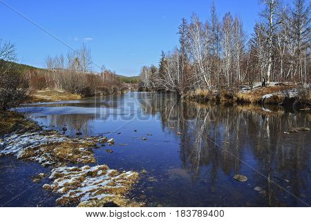 Autumn landscape with frosty trees. Landscape late autumn sun freezing river park