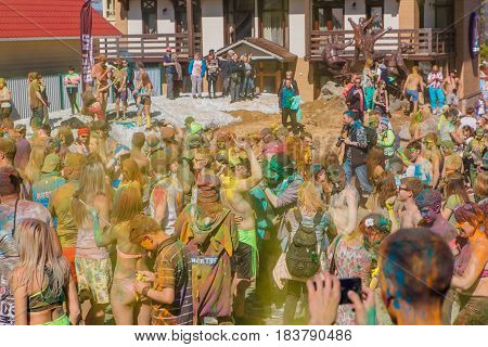 A Group Of A Young People Throwing Colorful Holi Powder.