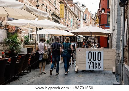 Leuven Belgium - July 30 2016: People walking by on commercial street with restaurants in the city of Leuven
