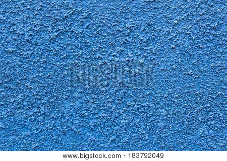 Abstract deep blue wall plastered texture. Rustic background.