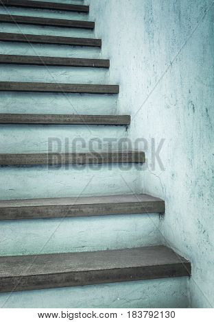 Rustic azure colored or concrete stairs outdoor with abstract pattern and texture.
