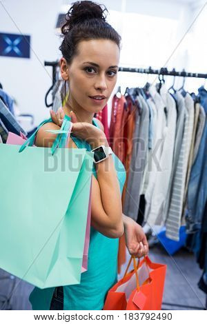 Portrait of women doing shopping at clothes store