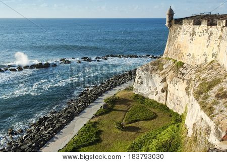 View of the coastline and outside wall of Fort El Morro in San Juan Puerto Rico