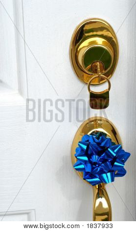 Lock And Door Handle Of New Home With A Blue Bow