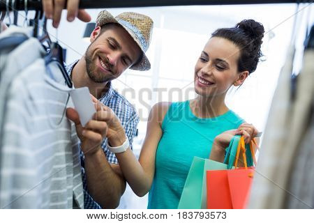 Happy couple doing shopping at clothes store