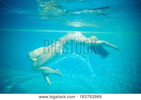 Underwater Portrait Of Beautiful Woman