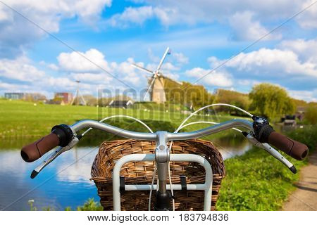 Bicycle and windmill. Symbols of the Netherlands. Tourism bicycle tour travel concept.