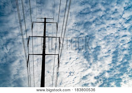 high voltage electric power supply pole on the cloudy sky background