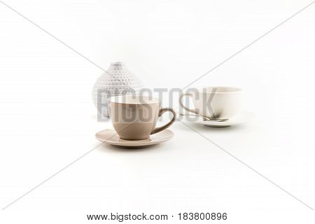 Two Cups Of Coffee And Vase Isolated On White Background