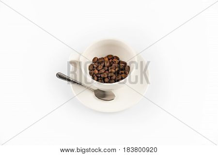 Coffee Beans In Coffee Mug With Spoon  Isolated On White