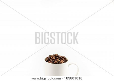 Roasted Coffee Beans In Coffee Mug  Isolated On White