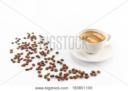 Coffee Beans And Cup Of Hot Coffee Isolated On White