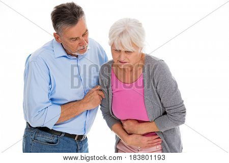 Man helping woman with a stomach pain