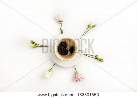 Top View Of Cup Of Hot Fresh Espresso Coffee And Beautiful Pink Flowers