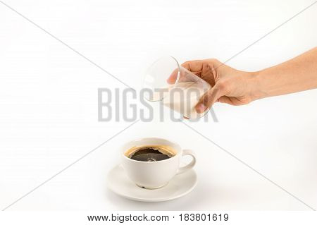 Cropped Shot Of Person Pouring Milk Into Cup Of Fresh Hot Coffee