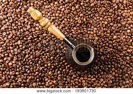 Top View Of Aromatic Coffee Beans And Turk With Beverage
