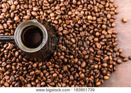 Top View Of Aromatic Coffee Beans And Turk With Coffee