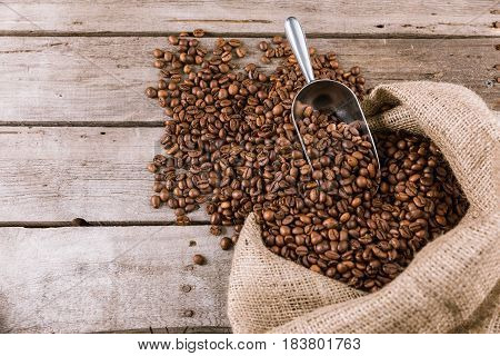 Coffee Beans And Scoop On Sack Cloth
