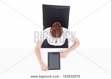 Overhead view of a young, confident businesswoman with tablet computer. Business, job, occupation, concept.