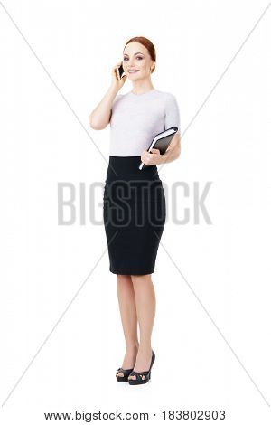 Young, confident, successful and beautiful business woman with organizer and smartphone isolated on white. Occupation, career, job concept.