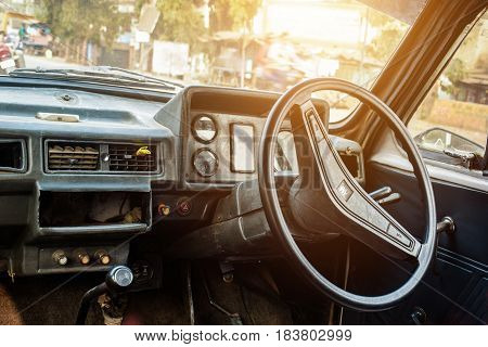 The Rusty Vintage looking Taxi Interior with wheel