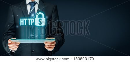 HTTPS - secured internet concept. Businessman or programmer with tablet and https text and padlock symbol.