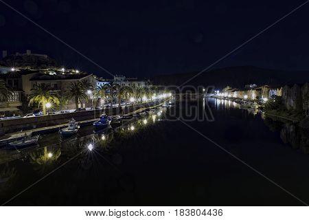 Night on Temo river crossing the city of Bosa. Sardinia Northwest Coast.