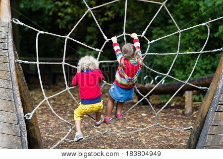 Children Climb On School Yard Playground