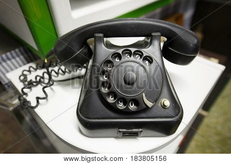 Old vintage telephone with rotary dial numbers. Vintage items back to basics retro love concept.