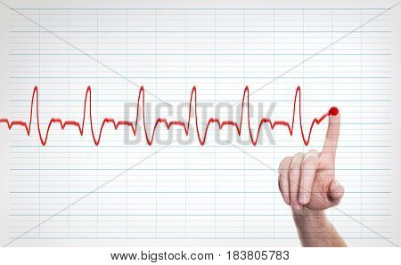 Male Doctor Hand Writing Virtual Cardiogram over Background