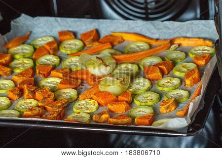Baked sweet potato zucchini and carrots in the oven.