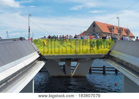 COPENHAGEN DENMARK - JULY 31 2016: Inderhavnsbroen a combined pedestrian and bicyclist bridge across the Copenhagen inner harbour. It measures 180 metres (590 ft).