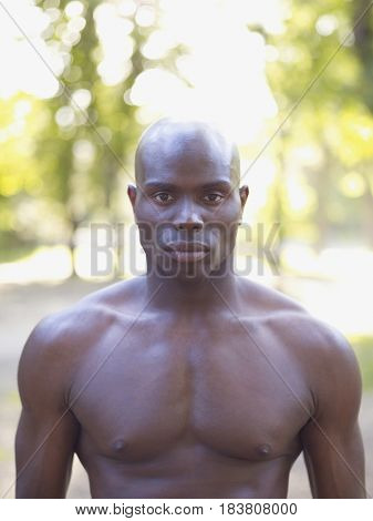 Serious African man with bare chest