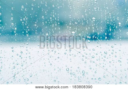 Rain Drops And Frozen Water On Window Glass Background, Blue Toning