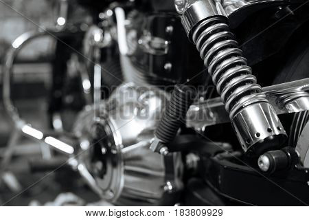 Power in every detail. Nice cool old motorcycle being repaired and maintained in lovely vintage garage