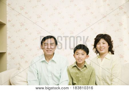 Chinese family smiling
