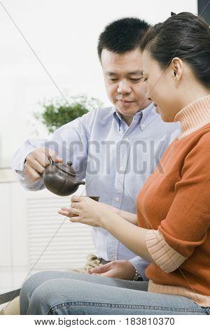 Chinese couple drinking tea