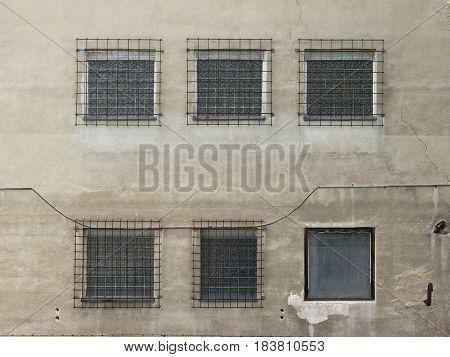 Factory building with water reservoir. Daylight, cloudy sky, the site of chemists from the 70s to 90s. Chemical industry for pharmaceuticals and antibiotics.