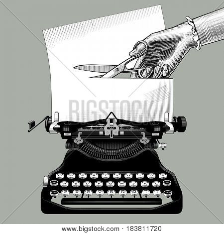 Woman's hand cutting a paper with scissors inserted into an old typewriter. Censorship concept and metaphor in retro style. Vintage engraving stylized  drawing