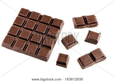 Chocolate cubes pieces of bitter dark chocolate bar isolated on white background.