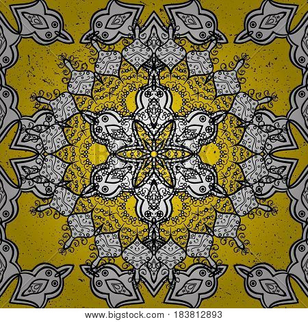 Damask pattern repeating background. Ornamental yellow floral ornament in baroque style. Antique ornamental repeatable sketch.Ornamental element on yellow background.