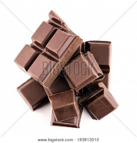 Chocolate cubes on heap pieces of bitter dark chocolate bar isolated on white background top view.