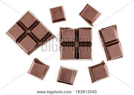 Chocolate cubes pieces of bitter dark chocolate bar isolated on white background top view.