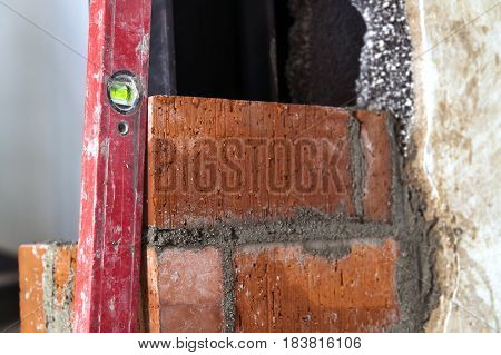 Close Up Of Bricklaying Industrial Installing Bricks On Construction Site Wall With Working Tools, M