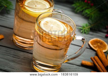Two Toddy Cocktail Drinks with Cinnamon on Rustic Wood