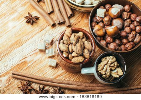 Cinnamon sticks and stars anise and nuts over  background