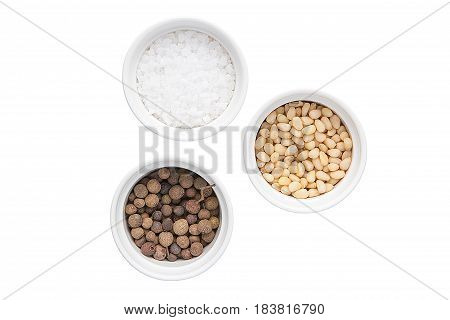 Sweet Pepper, Peeled Pine Nuts And Sea Salt On A White Background